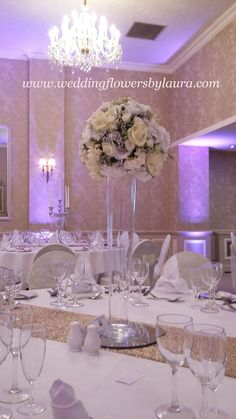These Vera Wang Inspired balls of roses look stunning on tall lily vases, and look beautiful alternated with candleabras with crystals by Blue leaf Event Hire. @blueleafevent  stunning  classic simple look. ( Rowton Hall Hotel) @rowtonhallhotel www.weddingflowersbylaura .com