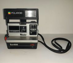 Polaroid Sun 600 LMS Land Camera with Strap. Battery seems to be dead. Not tested. | eBay!
