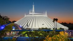 Dawn over the building that houses Space Mountain - Navigate a shadowy, neon-lit space station and make your way to a bustling Control Tower, passing a constellation of glowing astronaut training stations along the way. Inside a futuristic launch pad, board a sleek rocket-shaped vehicle and prepare yourself for a high-flying adventure into deep space. #WDW2017
