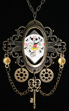 Steampunk necklace- Mickey Mouse with gears & key. Not sure about Mickey, but I like the rest of this design. And Mickey gives me ideas...