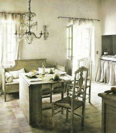 Sheer curtains in a French Provencial setting.