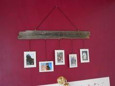 Vanha laudan pätkä, ja ohuella kettingillä roikkuu valokuvia rakkaista perheenjäsenistä!
