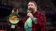 WWE Hall of Famer Mick Foley's announcement of the Championship quickly leads to its first-ever title bout. Mick Foley, Wwe Photos, Cool Photos, Wwe Money, Wwe Raw, Wwe Live Events, R Truth, Vince Mcmahon, Kevin Owens