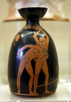 Aryballos dating from 490/480 BC, from the workshop of the painter Douris, painted with two enude ephebes training in wrestling. On the back two kalós love-inscriptions declare that Thodis and Chairippos are handsome. Exhibited in Room 8 of the Kerameikos Archaeological Museum (Athens). Picture by Giovanni Dall'Orto, November 12 2009.
