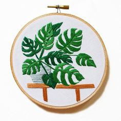 Sarah Benning's Monstera embroidered artwork, available to purchase from her Etsy shop.
