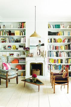 White library with small fireplace