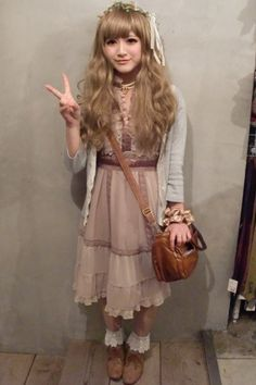Mori, cute: Beige lace dress with brown details. Headdress with flowers. White socks. Light brown shoes. Gray, green cardigan. Brown leather bag.