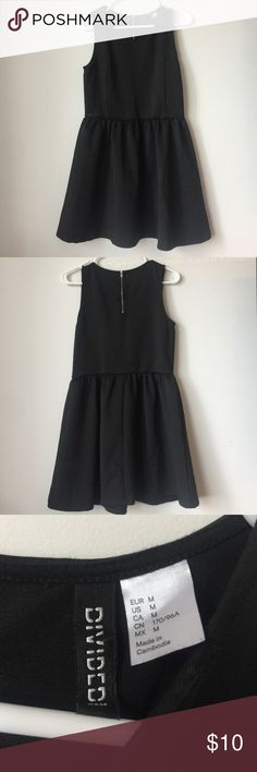 Black A-Line dress Cute black A-Line dress from H&M's Divided line. Flairs at the waist. Divided Dresses Midi
