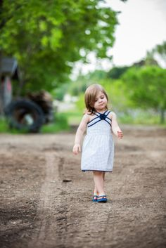 Outdoor Portraits Of Toddler Girl In Navy Dress By NikkiMayDay Photography