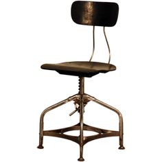 Polished steel and ebonized wood Toledo drafting stool | From a unique collection of antique and modern swivel chairs at https://www.1stdibs.com/furniture/seating/swivel-chairs/