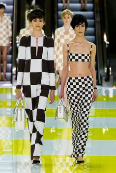 the bra top/skirt combo rocks. not as thrilled with the larger check outfit tho. Louis Vuitton