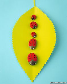 Lovely Ladybugs out of painted stoned    Ladybugs who lunch (on leaves) are elegantly attired in polka-dots.