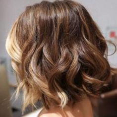 Short wavy brown hair with peaks of blonde through front and back of hair