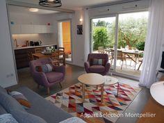 La cuisine et le salon de l'appartement Jardin Aiguelongue géré par Appart Selection