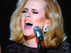 Adele: confident and classic, feminine and lovely. Give me some black eyeliner and some Aquanet and I'm there.  Simple LBD.  Powerful voice. And, that waifish look is not for me.  She is all that -- and a bag of chips -- and a Grammy winner!