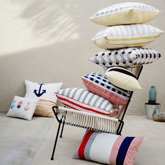 Oh, buoy. Printed on both sides with a nautical pattern that was conceived and painted by one of our designers, the Outdoor Anchors + Buoy Pillow brings a seafaring spirit to your patio or deck.