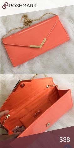 Aldo Clutch 10/10 condition as pictured. Chain strap so could be worn on the shoulder as well. Has a lil foundation smear in the inside of the bottom seam that's unnoticeable. Aldo Bags Clutches & Wristlets
