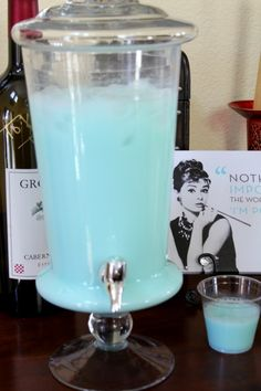 Another Breakfast at Tiffanys...with Tiffany blue punch and cupcakes and a mashed potato bar with the potatoes served in plastic martini glasses. Fun.