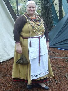 "Viking costume by Deborah Lane, suggesting that a folded panel might have been worn as an ""apron"" over the ""apron dress"" by Viking women."
