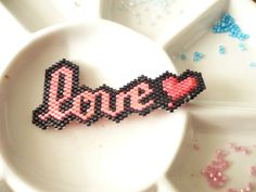 "My take of ""love"". Brick stitch brooch by Regina."