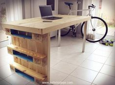 Now turning towards the next wooden desk, we gave it an industrial look by fixing couple of reclaimed metallic legs while the rest of the structure is made using the same shipping pallets. On side we have made the mandatory racks that give this desk a professional look.