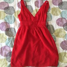 Red sleeveless dress Adorable red dress with a bow! Low cut adds drama! Hits above knees. Size S. Perfect for a date night! Alice Moon Dresses