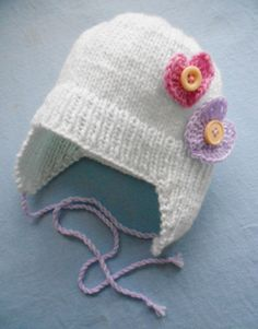 Baby girl ear flap knitted hat with hearts