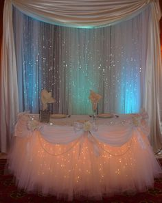 All White Fantasy Table Skirt(R), Crystal Backdrop and Uplights. www.sbdevents.com