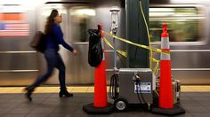 A woman walks by a device used for chemical tracers used by the Department of Homeland Security and New York Metropolitan Transportation Authority during a test of how gas would flow through the subway system in New York, US, May 9, 2016. (Reuters)