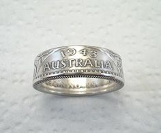 This listing is for a custom handcrafted Australia Sterling Silver Florin Coin Ring with a crevice toned finish. (.925 Silver) The size choices are: sizes 7 - 11 1/2. The Date, Australia and Florin can be seen on the outer band. Be sure to put your finger size in the text field when placing your order.    The date, the tone (color) and shape of your ring may not be exactly as shown in the example photos. Larger sizes have flatter bands. Smaller sizes are more rounded.    **PLEASE KNOW YOUR…