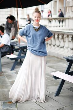 loose sweatshirt with pleated skirt and chunky necklace
