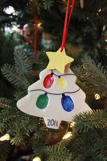 Family Christmas Tree Ornament - white sculpey, paint, and pinky prints as the lights!  Make one every year!