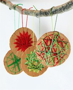 Do not open, but children can make these ornaments. Just cut down partially all around the circle. Let them wrap with colored string. How they wind, skip every other one, or go diagnally or skip 4 to wrap. Intersting combinations can be made by alternating color. (Too bad the link was compromised. Do not open because it is blocked and damaged. BUT, you can still follow the fun idea.) MamaPat