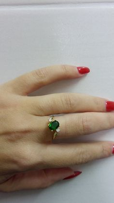 Handmade! Exquisite and scrupulous working Super thin and feminine ring with a lovely round brilliant cut crystals  Ask her to marry you with this stunning and traditional engagement ring!   Center Stone : Lab grown Emerald (6*8mm) Other Stones Color: Clear Quartz (2 stones) Gemstone Cut - Faceted Metal Type -14k Gold Filled (Tarnish Resistant And Nickel Free) - also available in Sterling silver 925  My another shop on Etsy  http://www.CandyBohoJewelry.etsy.com  http://www...