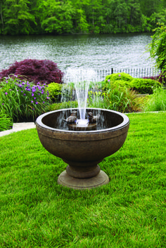 The Fleur De Lis Bird Fountain is a low maintenance feature. This feature is ideal for a smaller garden. The feature is made in the USA by Massarelli's - the market leaders in Cast Stone fountains
