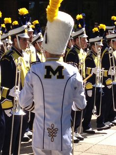 U-M's drum major inspects the band before it marches to the stadium!