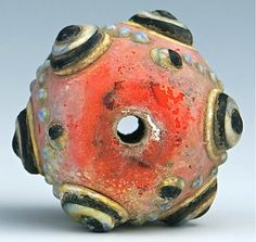 This is a very old and unusual chinese glass sand stone, colored bead. Colorful glass bead with applied protruded banded decorations, measures approx.