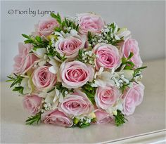 Bouquet of pale pink Sweet Avalanche roses, white freesia, a touch of gypsophila and rosemary make a gorgeous classic wedding bouqet