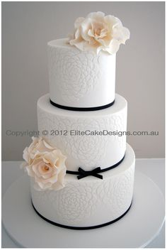 Wedding Cake with ivory roses and camelia decorated cake