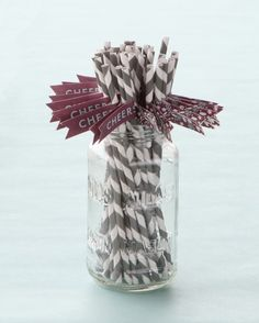 To bring the stationery motif into the table details, Minted printed a set of adhesive drink flags which were attached to gray and white paper straws from Paper Source.