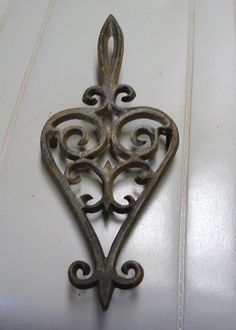1952 CAST IRON TRIVET by neilsellers on Etsy, $27.00