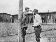 French prisoner tied to a stake at Zwickau prison camp is given a drink by a fellow POW, Germany, 1917 [[MORE]]marquis_of_chaos:Life archive hosted at Google