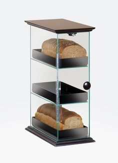 Westport Bread Display Item: 1204-52. This classic 3 tier bread case can be styled in three different ways. If you are looking for something more simple and fresh, the case comes in all clear acrylic with no base. For a unique and modern twist, add on a black base or wood accent! Any of these bread cases will complement your bakery, cafe, or food service area. http://www.calmil.com/index.php?page=shop.product_details&flypage=flypage.tpl&category_id=4&product_id=90&option=com_vi
