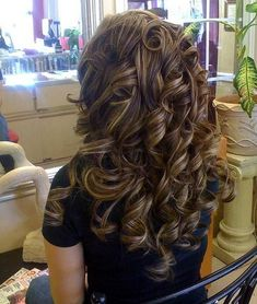 Thick curly brunette hair with caramel blonde low-lights by Brooklyn Barbie Doll