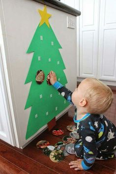 a Photo Christmas Tree for Babies & Toddlers Toddler Approved!: Build a Photo Christmas Tree for Babies & ToddlersToddler Approved!: Build a Photo Christmas Tree for Babies & Toddlers Photo Christmas Tree, Christmas Tree Crafts, Preschool Christmas, Noel Christmas, Holiday Crafts, Holiday Fun, Outdoor Christmas, Toddler Christmas Crafts, Christmas Crafts For Kids To Make Toddlers
