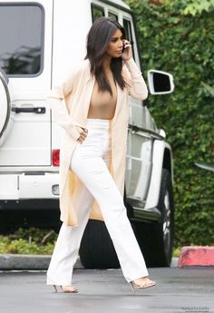 Kim K in all nude tones | Long cardigan, white pants, camel shirt