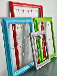 picture frames with wire strung across and tiny clothes pins …