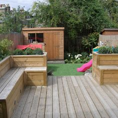 Greenroom Landscaping - decked garden with raised planters/seating and artificial turf for a low maintenance family garden