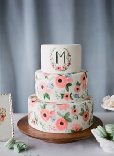 Such a pretty monogrammed water color cake.