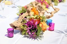perfect wedding arrangements for beach made of grape branches and colorful flowers